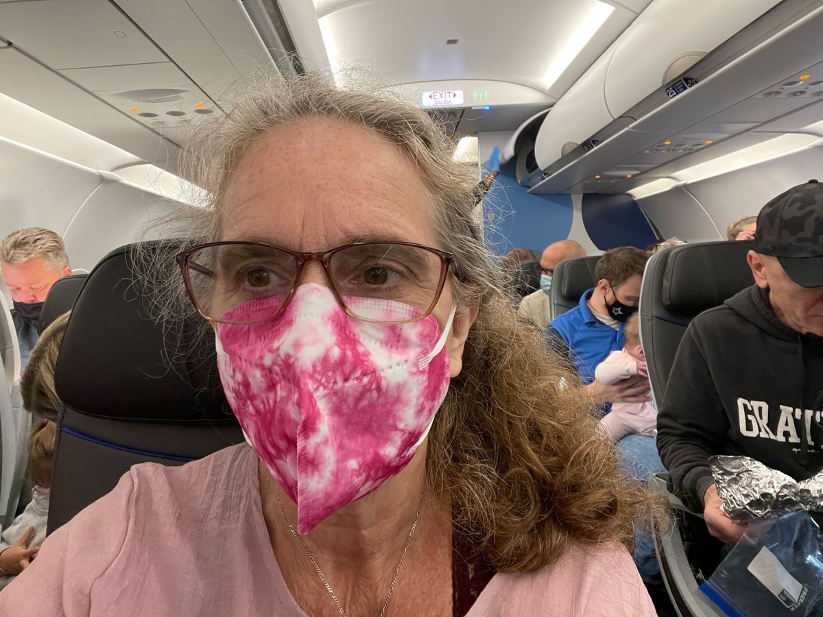 Christiana Masked on an Airplane